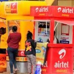 Customers accessing mobile money services from, mobile operator stalls